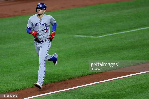 Cavan Biggio of the Toronto Blue Jays rounds the bases after hitting a solo home run against the Baltimore Orioles in the fourth inning at Oriole...