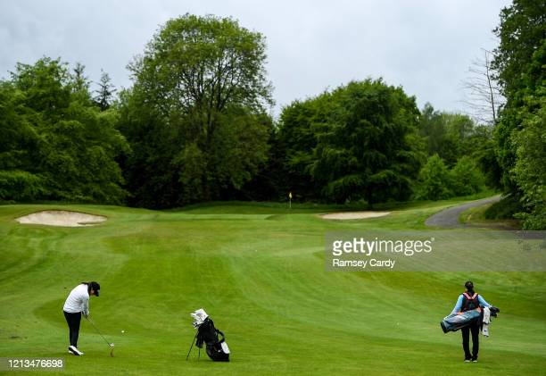 Cavan Ireland 18 May 2020 Irish professional golfer Leona Maguire hits her second shot on the 3rd hole watched by her twin sister and former...