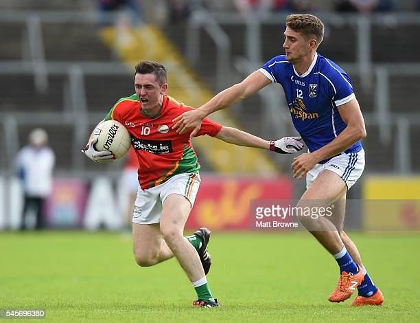 Cavan Ireland 9 July 2016 Alan Kelly of Carlow in action against Killian Clarke of Cavan during the GAA Football AllIreland Senior Championship Round...