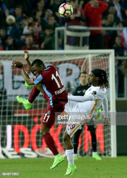 Cavanda of Galatasaray in action against Fabian Castillo of Trabzonspor during the Turkish Spor Toto Super Lig football match between Trabzonspor and...