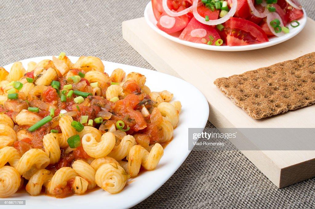 Cavatappi Pasta with sauce of stewed vegetables closeup : Stock Photo