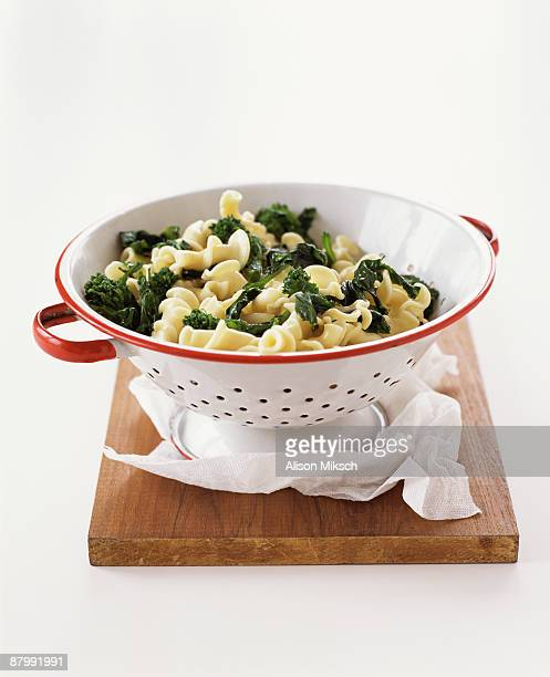 Cavatelli pasta and broccoli rabe in strainer