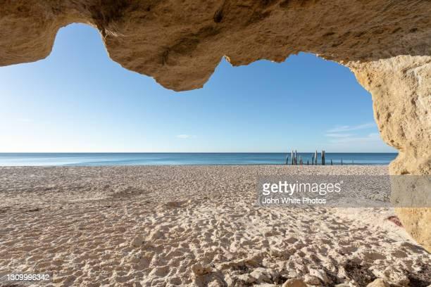 cave and jetty pylons. port willunga. south australia. - ウィランガ ストックフォトと画像