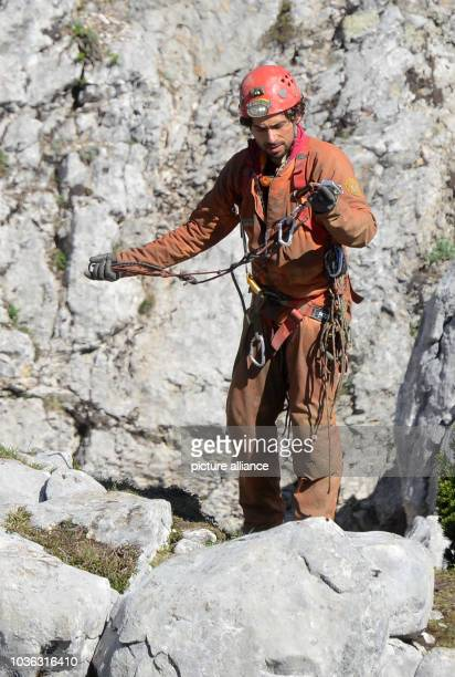 A cave and mountain rescue expert from Italy holds a rope in his hand as he prepares for his descent into the Riesending cave on the Unterberg...