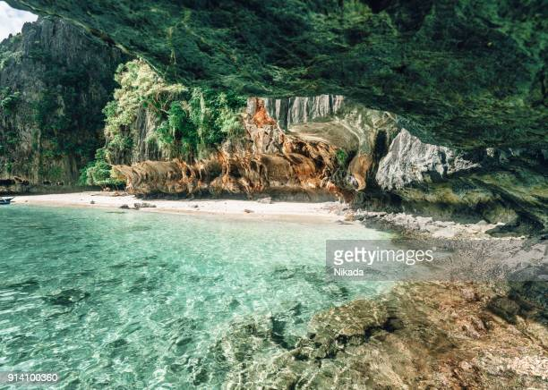cave at the beach, el nido palawan, philippines - el nido stock pictures, royalty-free photos & images