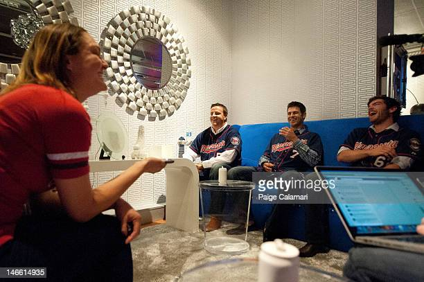 Cave Dweller Lindsay Guentzel calls her father to say hello with Minnesota Twins Matt Capps Joe Mauer and Liam Hendriks during their visit to the MLB...