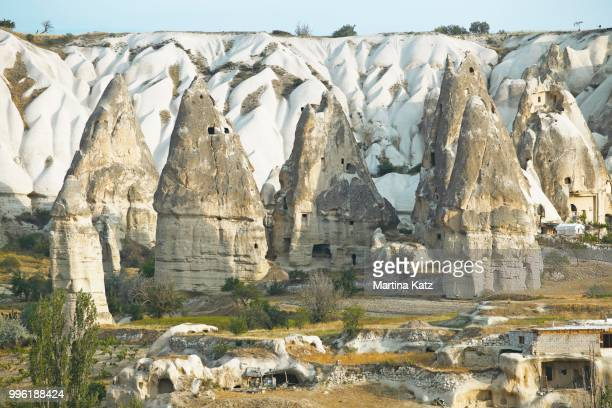 cave dwellings and tufa formations, goereme, nevsehir province, cappadocia, anatolia, turkey - central anatolia stock photos and pictures