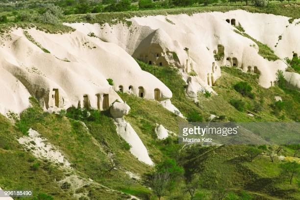 cave dwellings and tufa formations, uchisar, nevsehir province, cappadocia, anatolia, turkey - central anatolia stock photos and pictures