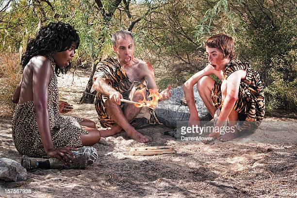 cave family - caveman stock photos and pictures