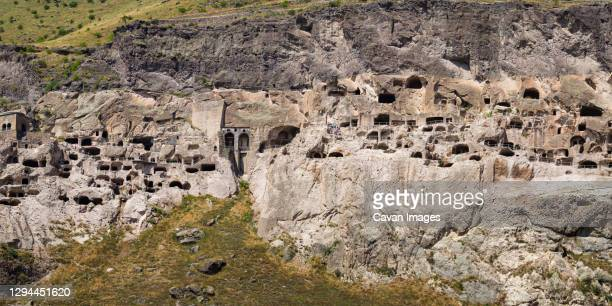 cave monasteries at vardzia during sunny day, georgia - bedrock stock pictures, royalty-free photos & images