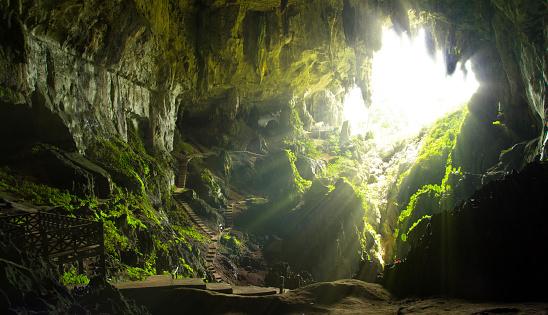 Cave opening in Borneo, Malaysia 1037397530
