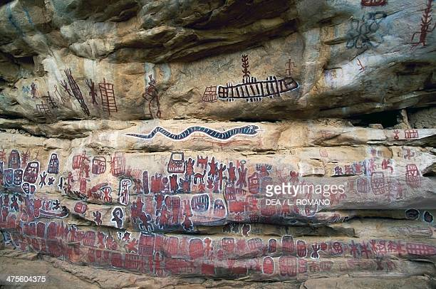 Cave paintings with figures and symbols of the Dogon Sangha or Songo people Bandiagara Escarpment Mali