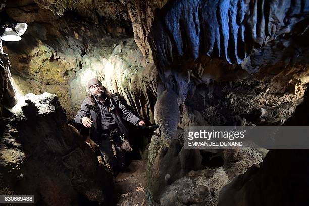 Cave specialist Christian Casseyas gives a tour of the Goyet cave where 96 bones and three teeth from five Neanderthal individuals were found in...
