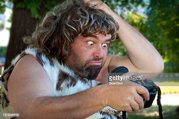 caveman and camera - caveman stock photos and pictures