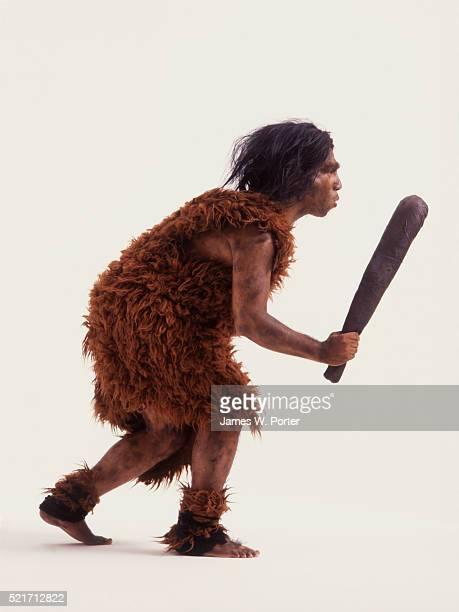 caveman bearing club - caveman stock photos and pictures