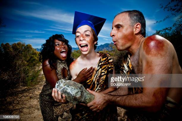 caveman graduation - caveman stock pictures, royalty-free photos & images