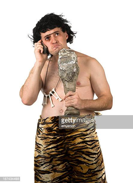 caveman on phone - caveman stock photos and pictures