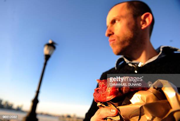 Caveman' Vlad Averbukh a follower of 'The Paleo Diet' eats raw meat along the Hudson River in New York February 04 2010 Vlad an adept of America's...