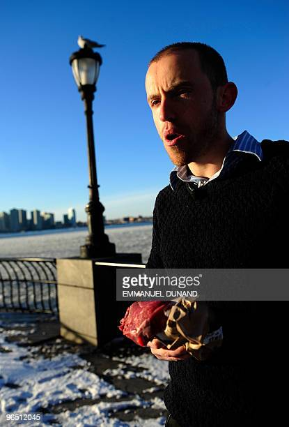 Caveman Vlad Averbukh a follower of The Paleo Diet eats raw meat along the Hudson River in New York February 04 2010 Vlad an adept of America's paleo...