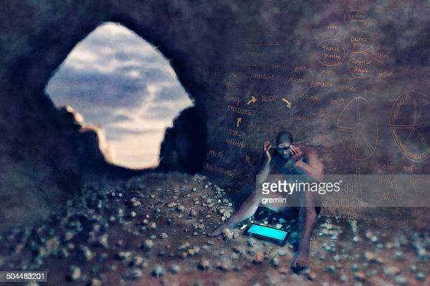 caveman with digital tablet and business problems - caveman stock pictures, royalty-free photos & images
