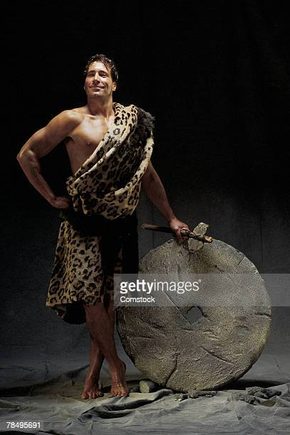 caveman with wheel - caveman stock pictures, royalty-free photos & images
