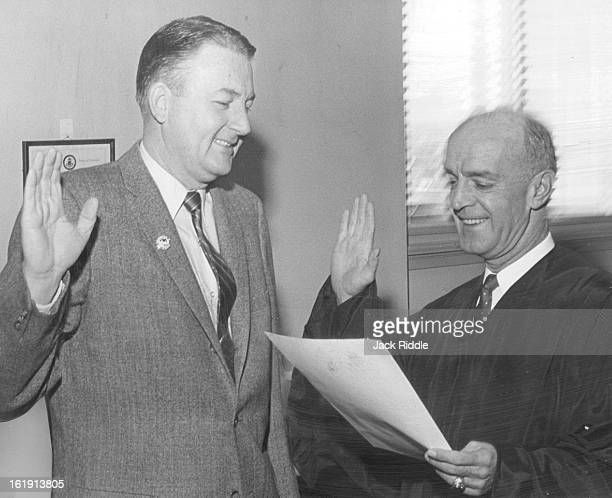 OCT 31 1960 Cavender Joins Zoning Adjusters Dist Judge Edward J Keating administers oath of office to George Cavender newly elected member of the...