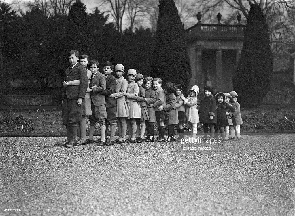 Cavendish family group of 16 grandchildren in the gardens of Chatsworth, Derbyshire, Christmas 1929. Artist: JR Board : News Photo
