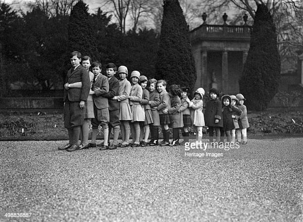 Cavendish family group of 16 grandchildren in the gardens of Chatsworth Derbyshire Christmas 1929 The grandchildren of Victor Cavendish 9th Duke of...