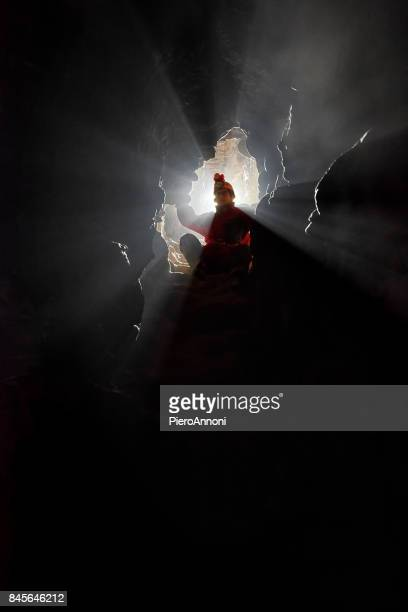 caver exploring a narrow passage - speleology stock pictures, royalty-free photos & images