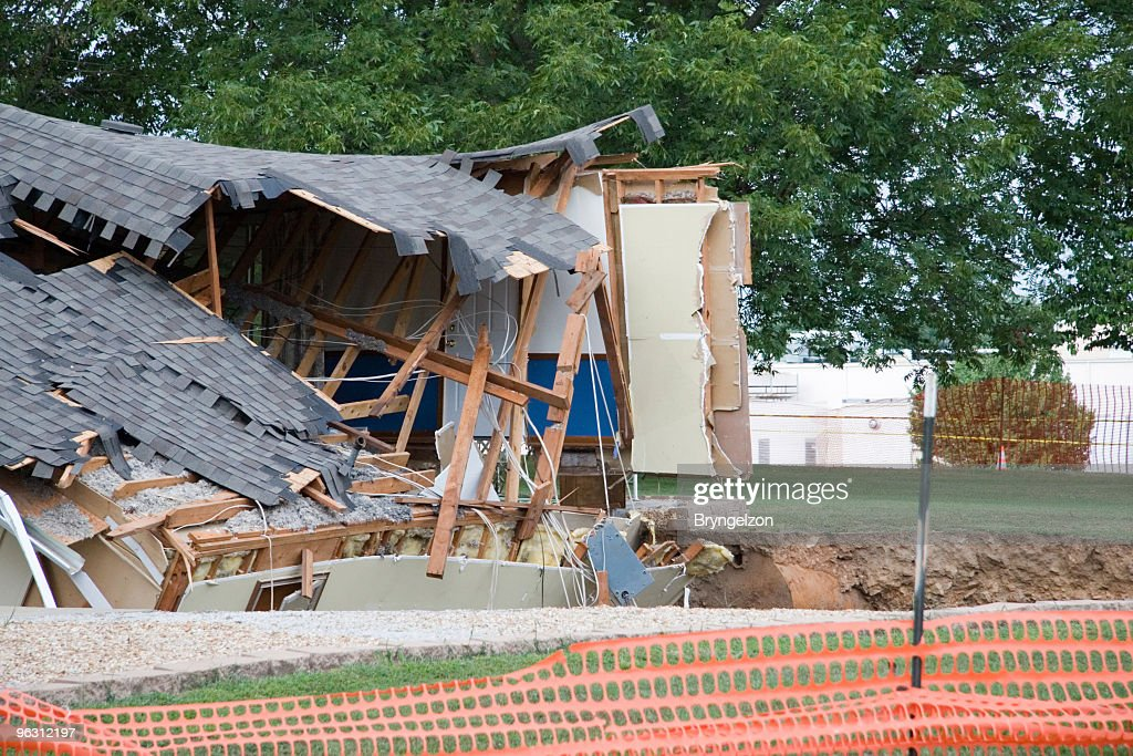 Cavern Swallows a Home : Stock Photo