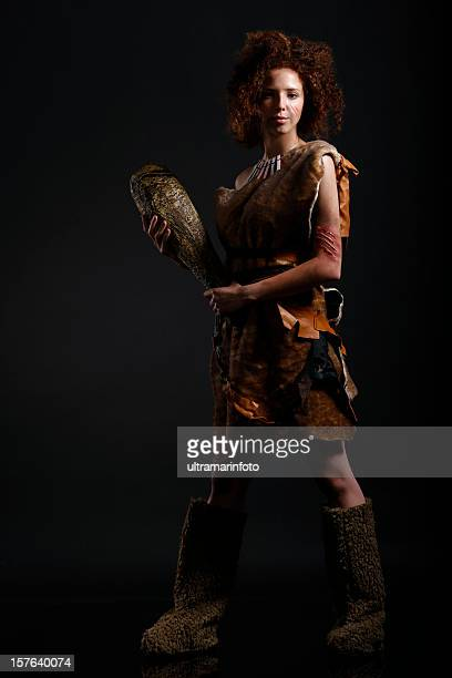 cavewoman - stone age stock photos and pictures