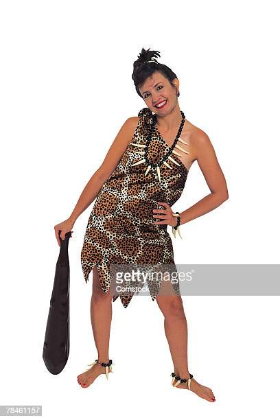 cavewoman posing with club - cavewoman stock pictures, royalty-free photos & images