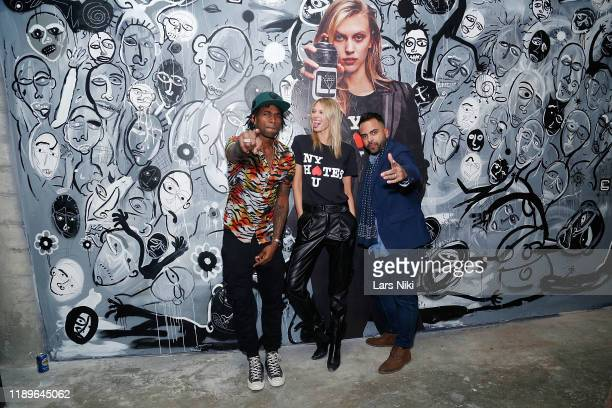 Cavier Coleman Juliana Schurig and Edward Costa attend the private opening of the Good Luck Dry Cleaners Bowery location at 3 East 3rd on December 19...