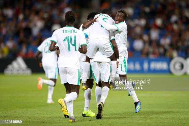 Cavin Diagne of Senegal celebrates with team mates after scoring his team's first goal during the 2019 FIFA U20 World Cup Quarter Final match between...