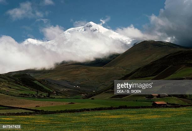 Cayambe volcano shrouded by clouds Cordillera Central Andes Ecuador