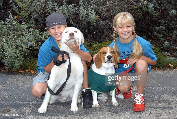 Cayden Boyd Cooper Jenna Boyd Buddy during 4 Paws For A Cure Dogwalk to Fun National Childhood Cancer Foundation at La Brea Tar Pits in Los Angeles...