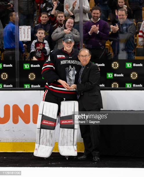 Cayden Primeau of the Northeastern Huskies accepts the tournament Most Valuable Player Award from Steve Nazro after a game against the Boston College...