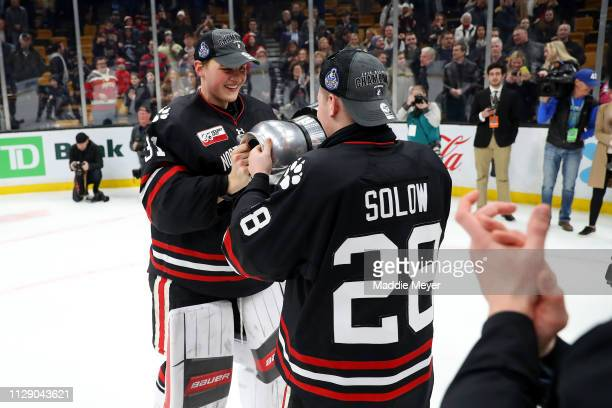 Cayden Primeau of the Northeastern Huskies and Zach Solow celebrate after winning the 2019 Beanpot Tournament Championship game against Boston...