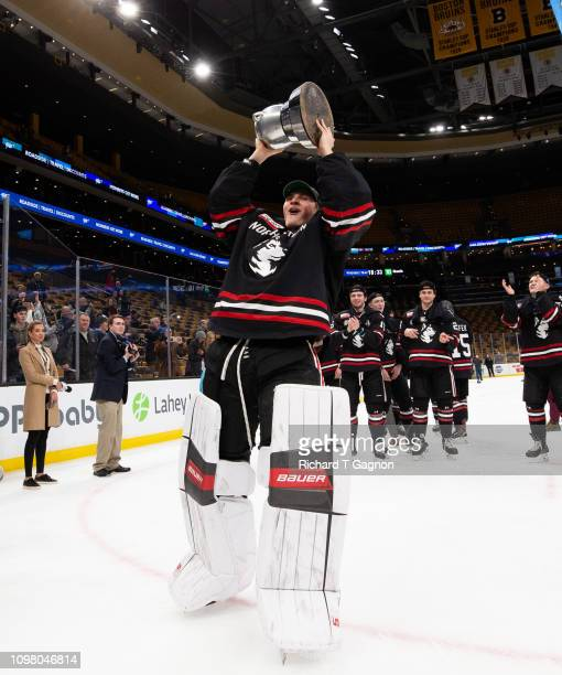 Cayden Primeau of the Northeastern Huskies celebrates a 42 Beanpot victory against the Boston College Eagles during NCAA hockey in the championship...