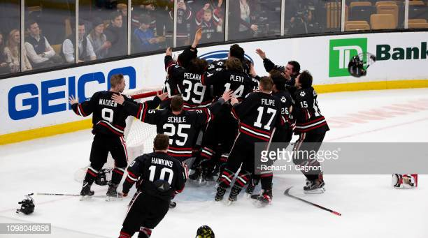 Cayden Primeau of the Northeastern Huskies celebrates a Beanpot victory against the Boston College Eagles with his teammates during NCAA hockey in...