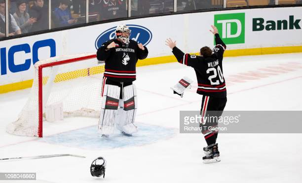 Cayden Primeau of the Northeastern Huskies celebrates a Beanpot victory against the Boston College Eagles with teammate Eric Williams during NCAA...