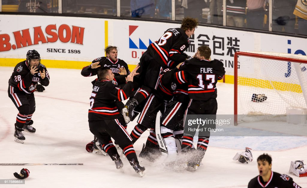 Cayden Primeau #31 of the Northeastern Huskies celebrates with his teammates Eric Williams #20, Matt Filipe #17 and Biagio Lerario #26 after a game against the Boston University Terriers during NCAA hockey in the championship game of the annual Beanpot Hockey Tournament at TD Garden on February 12, 2018 in Boston, Massachusetts. The Huskies won 5-2 to capture their first Beanpot in 30 years.