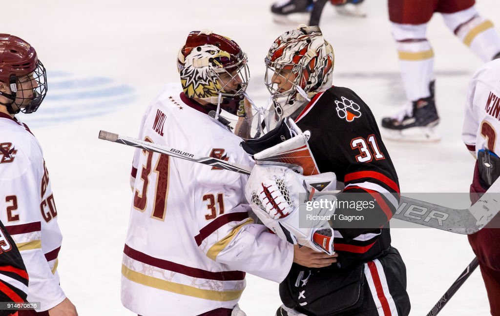 Cayden Primeau #31 of the Northeastern Huskies hugs Joe Woll #31 of the Boston College Eagles after NCAA hockey in the semifinals of the annual Beanpot Hockey Tournament at TD Garden on February 5, 2018 in Boston, Massachusetts.