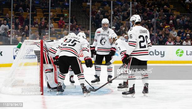 Cayden Primeau of the Northeastern Huskies is surrounded by his teammates before NCAA hockey against the Boston College Eagles in the Hockey East...