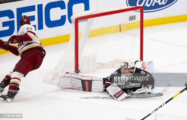 Cayden Primeau of the Northeastern Huskies makes a save against Marc McLaughlin of the Boston College Eagles during NCAA hockey in the championship...