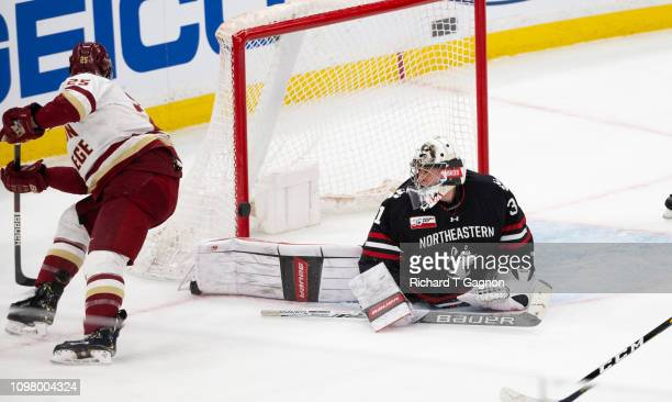 Cayden Primeau of the Northeastern Huskies makes a save against the Boston College Eagles during NCAA hockey in the championship game of the annual...