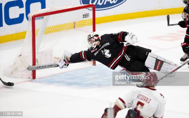 Cayden Primeau of the Northeastern Huskies makes a sprawling save against the Boston College Eagles during NCAA hockey in the championship game of...