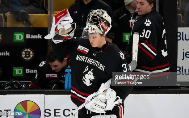 Cayden Primeau of the Northeastern Huskies takes a breather during a game against the Boston College Eagles during NCAA hockey in the championship...