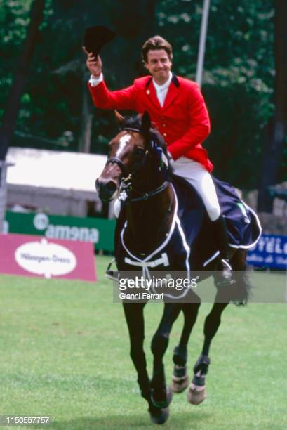 Cayetano Martínez de Irujo y FitzJames Stuart 4th Duke of Arjona waves his cap as he rides in an unspecified equestrian contest hipico Madrid Spain...