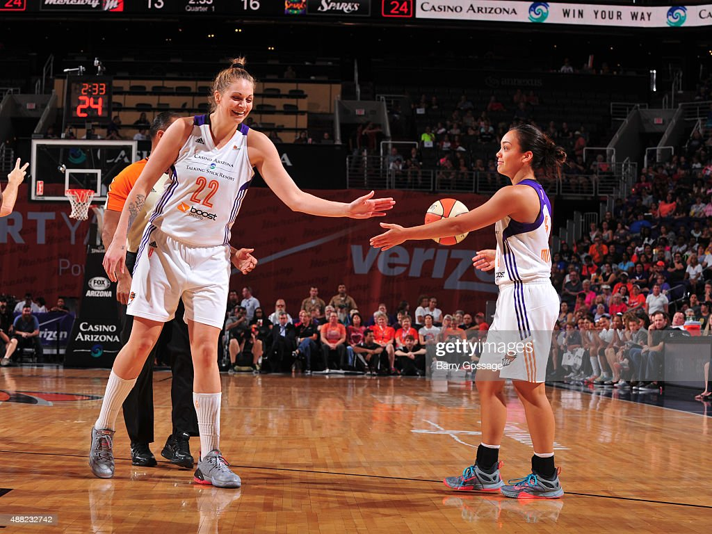 Cayla Francis #22 and Leilani Mitchell #5 of the Phoenix Mercury high five during the game against the Los Angeles Sparks on September 11, 2015 at the US Airways Center in Phoenix, Arizona.